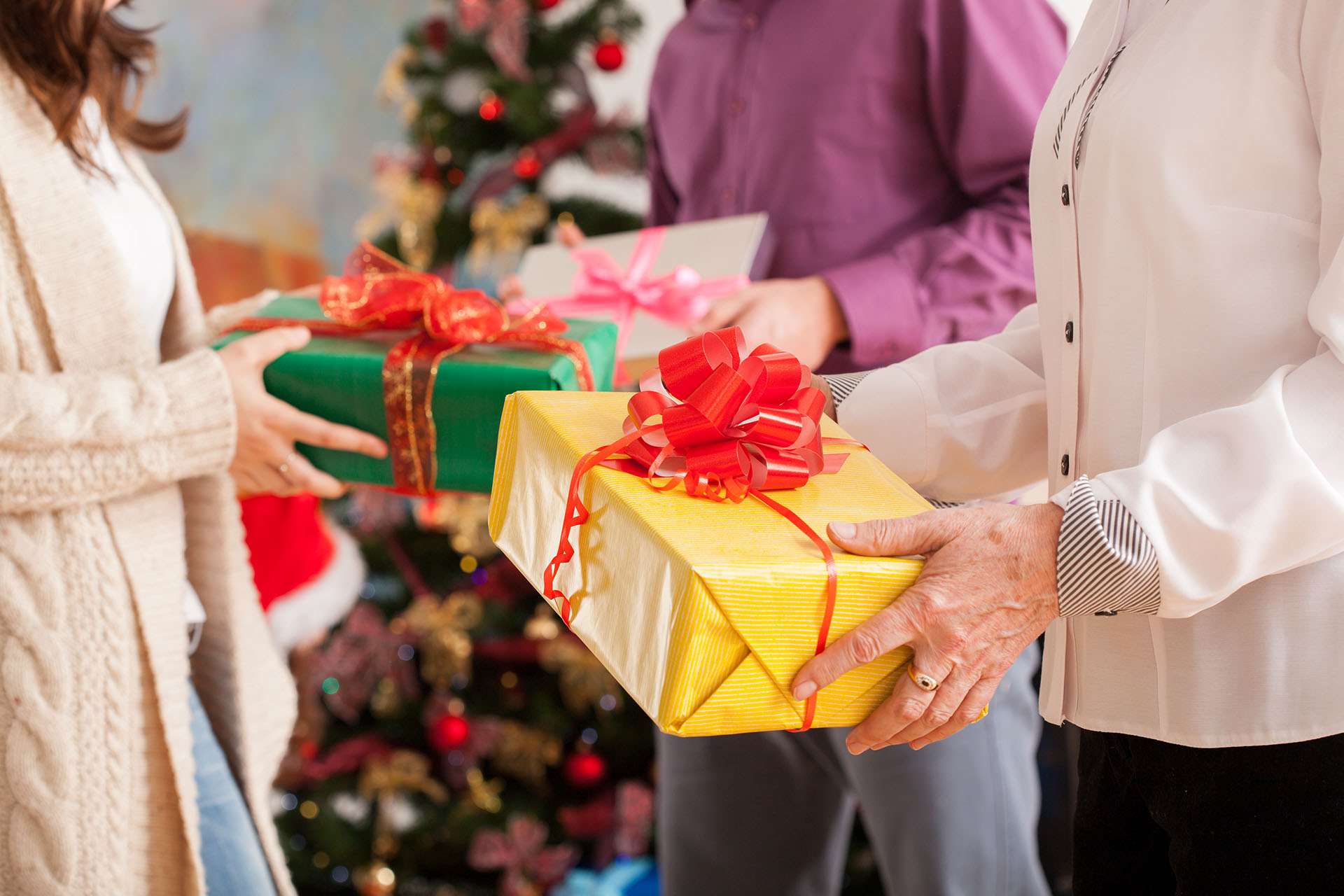 Happy family exchanging theirs Christmas gifts ; Shutterstock ID 234656959; PO: 666